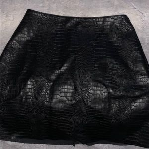 Faux snake skin leather skirt.